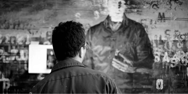 Martin Bureau devant son œuvre Dématérialisation du médium. Huile et acrylique sur toile (152 x 214 cm), 2010. Photo Larry Rochefort